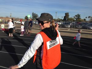 Sheri volunteering to help with security at a wellness event.