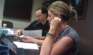 Sheri Gilbert goes over business retention planning with Bill Munch, procurement expert.
